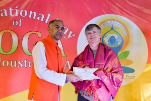 Charles MacInerney receiving a Yoga service award from the Consul General of India.